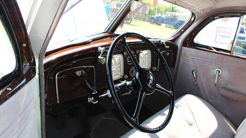 Streamlined handles, fine wooden inlays and bold patterns on the dash gauges, Photo Credit: Karl Bhote
