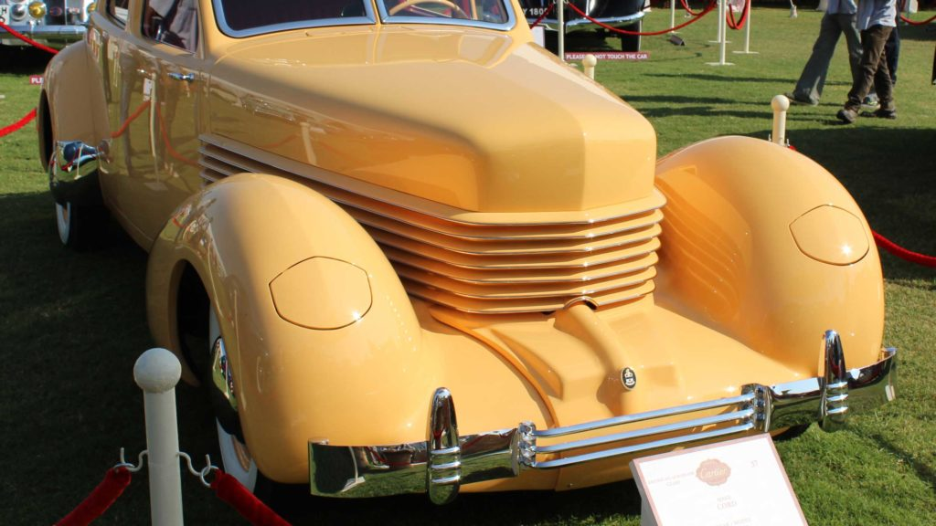 Closeup view of the compassing bonnet highlighted by horizontal lines and concealed pop up headlights, Photo Credit: Karl Bhote