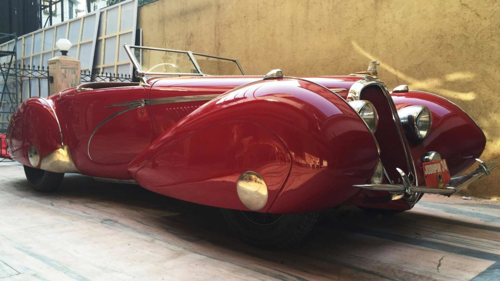 View of Eagle shaped car mascot, radiator grilles, French airplanes and tear drop inspired fenders and silver streamline inspired bands on Delahaye 135MS 1939, Photo Credit: Karl Bhote