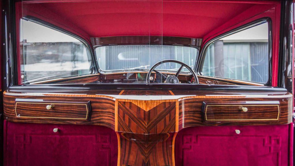 Passenger view of the rich wooden and velvet upholstered deco details inside Hispano Suiza J12; Photo Credit: https://www.artcurial.com/en/lot-1937-hispano-suiza-j12-gurney-nutting-3279-28