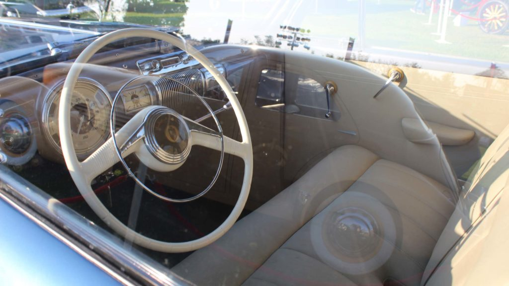 View of the dashboard, steering wheel and upholstery inside Lincoln Zephyr 1941, Photo Credit: Karl Bhote