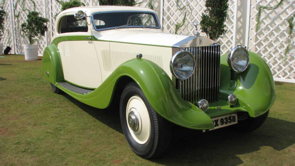 View of Rolls-Royce Phantom II that highlights the streamline design and significant deco details, Photo Credit: Karl Bhote