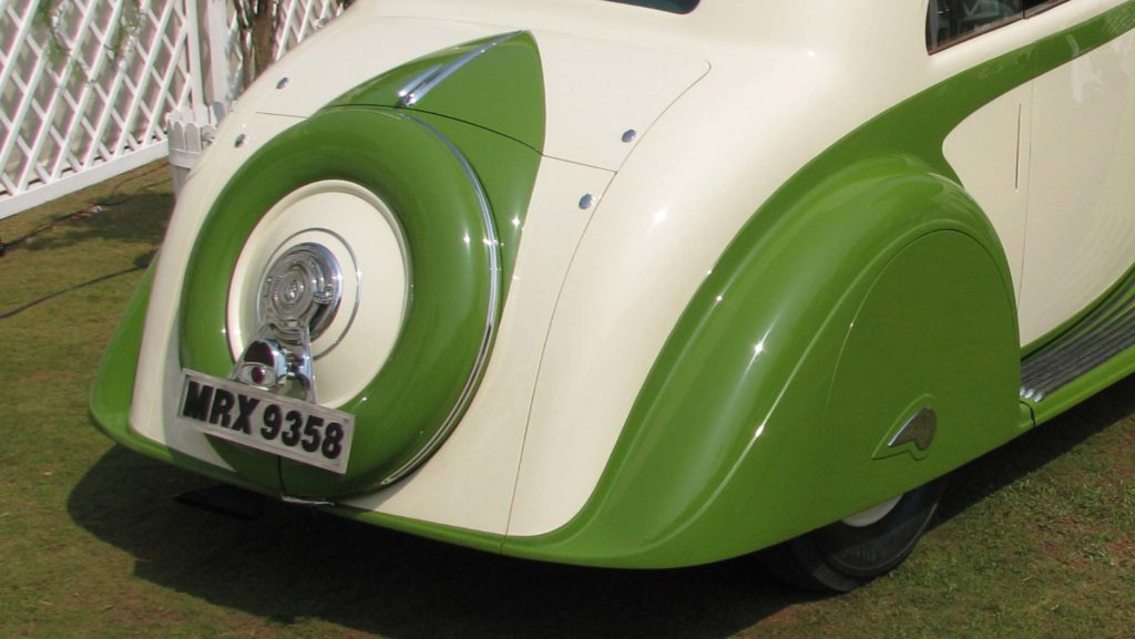 Closeup view of the rear wheel spats with teardrop motif and the rear fenders designed to enclose the wheels, Photo Credits: Karl Bhote