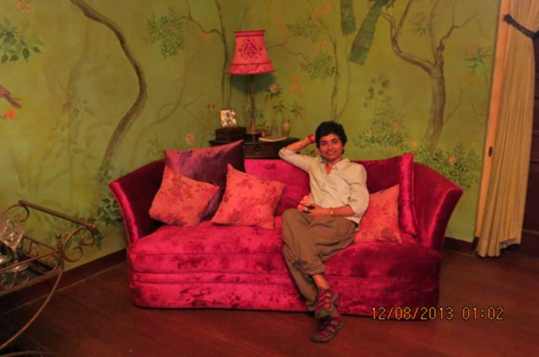 In the midst of a busy shoot at Tissamaharama in Sri Lanka, Sonal poses for the camera on a red velvet Deco sofa used in the film. Photo courtesy: Dhara Jain