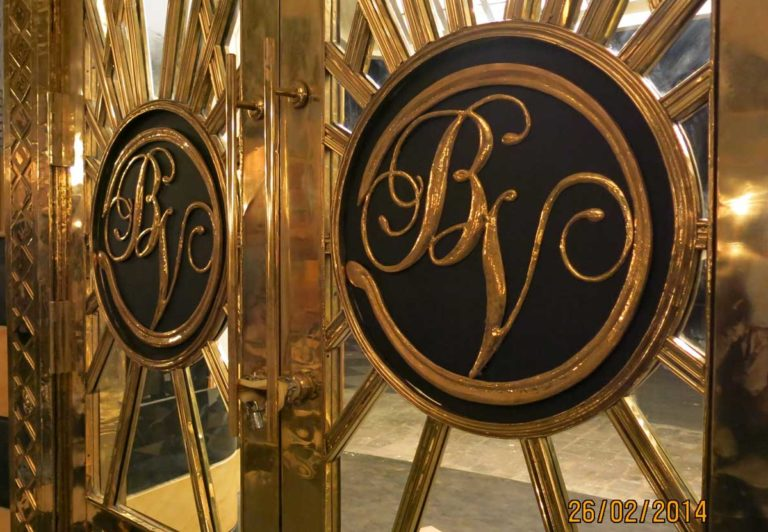 The magnificent entrance doors of the Bombay Velvet Club, made of brass, with the distinctly Deco sunburst motif. Photo courtesy: Dhara Jain