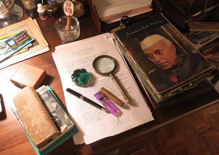 Props assembled on a desk. Props used in spaces inhabited by characters are an important window into their personality. Photo courtesy: Sonal Sawant