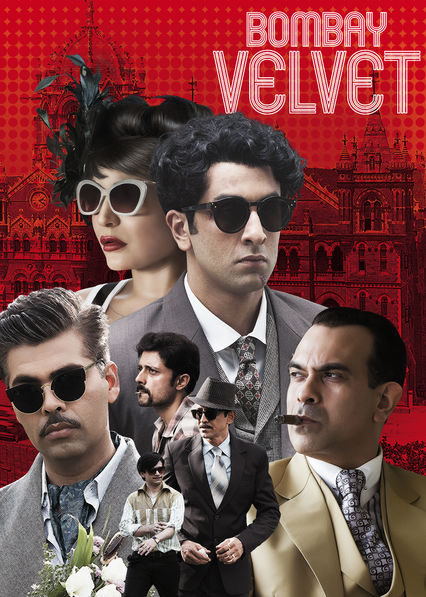Clothes, sunglasses and hairstyles recreate the period look with Victoria Terminus now called Chhatrapati Shivaji Maharaj Terminus in the background to contextualise Bombay Picture Credits: Netflix USA
