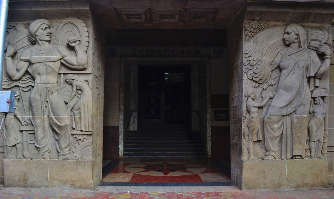 Bas-reliefs flanking the entrance of the New India Assurance Building. Source: Maya Sorabjee