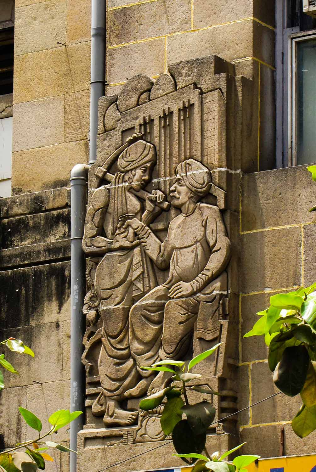 Figure 13: Bas-relief of a moneylender on the façade of the Western India House. Source: Art Deco Mumbai