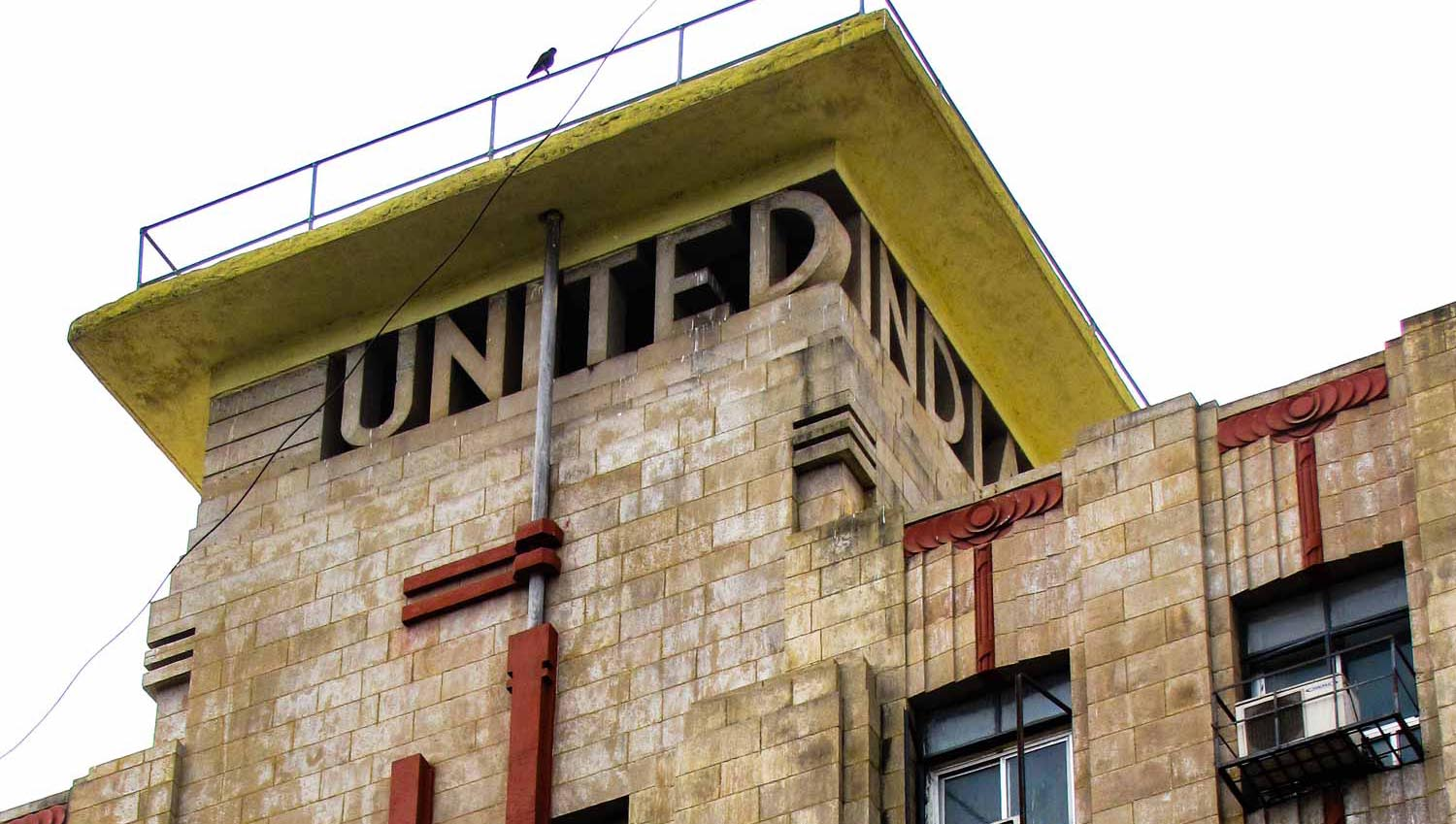 Lettering embedded into the tower of United India Building. Iyengar & Menzies. 1937–1939. Bombay, India. Source: Art Deco Mumbai