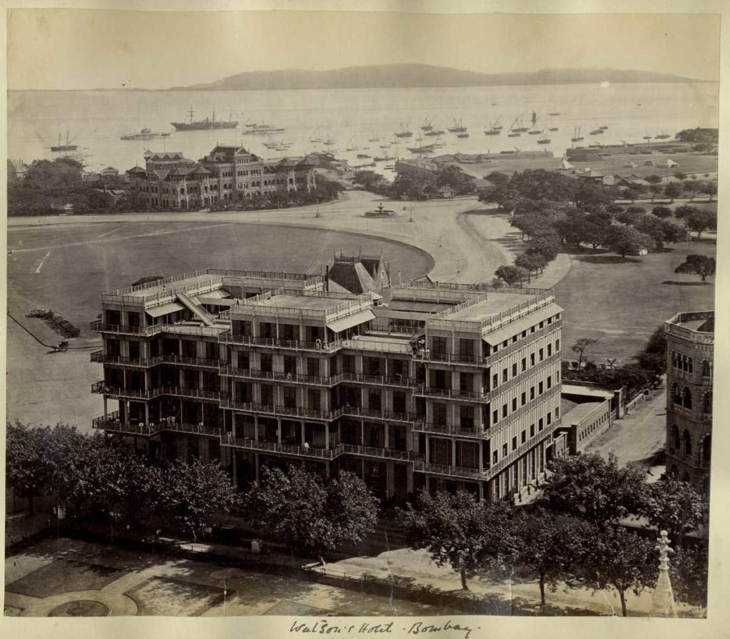 A stunning view of the Watson's Esplanade hotel with the backdrop of the Maharashtra Police Headquarters on the far left and an open space behind. The hotel was one of the first cast iron-framed structures in India.
