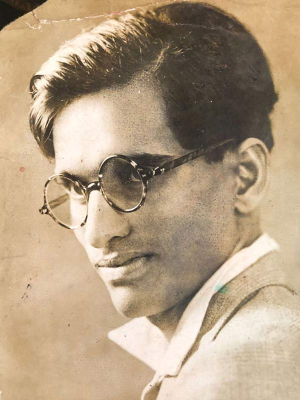 A dapper young Pansare with neatly styled hair and spectacles; Source: Pansare Family Archive