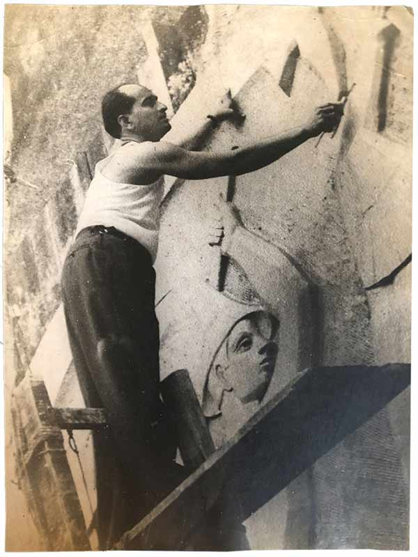 Pansare (wearing dark coloured trousers) working on the reliefs on the Ashoka Hotel in Delhi in the 1950s. The mural he is pictured carving here was 22 feet tall; Source: Pansare Family Archive