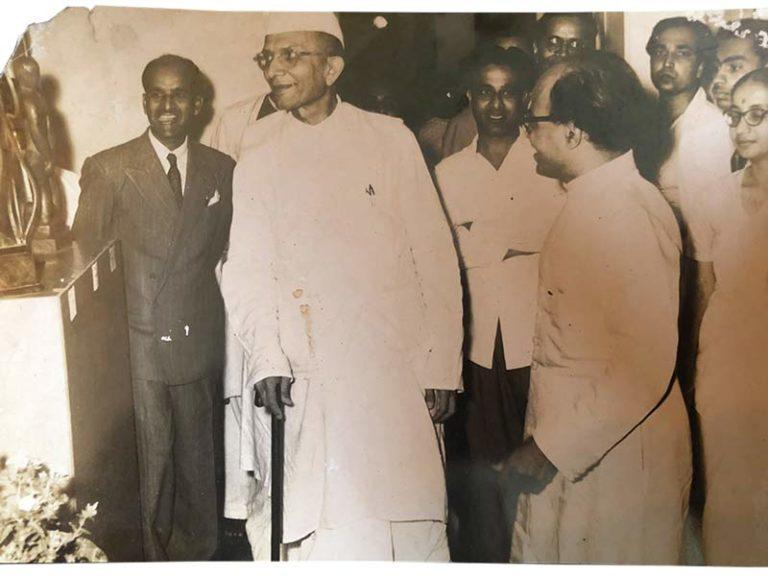 Pansare (on left, wearing dark suit and tie) with the then Chief Minister Morarji Desai and Mr. Kamat (on right, wearing spectacles) on the other side of Desai; Source: Pansare Family Archive